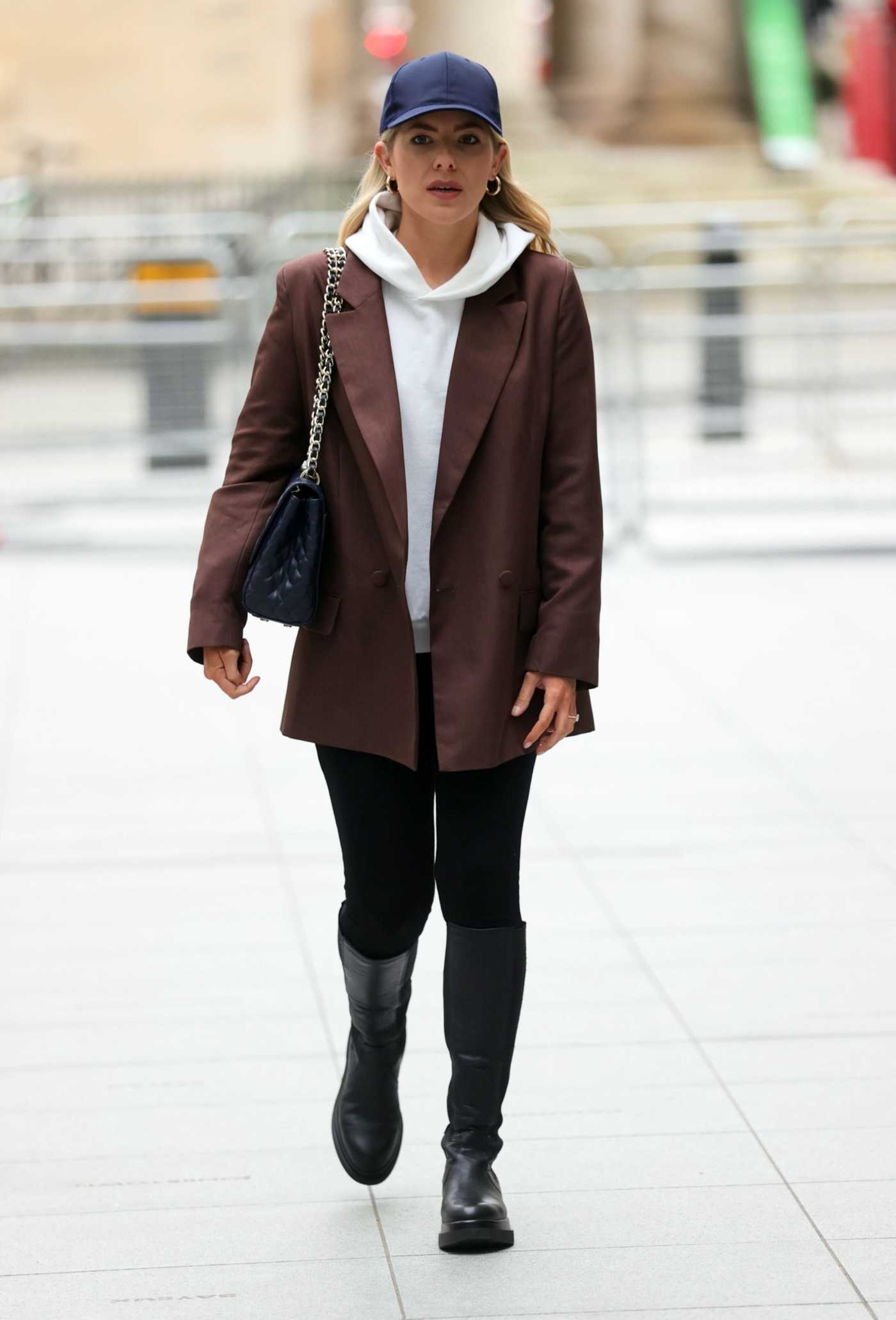 Mollie King in a Brown Blazer Arrives at the BBC Studios in London 02/19/2021