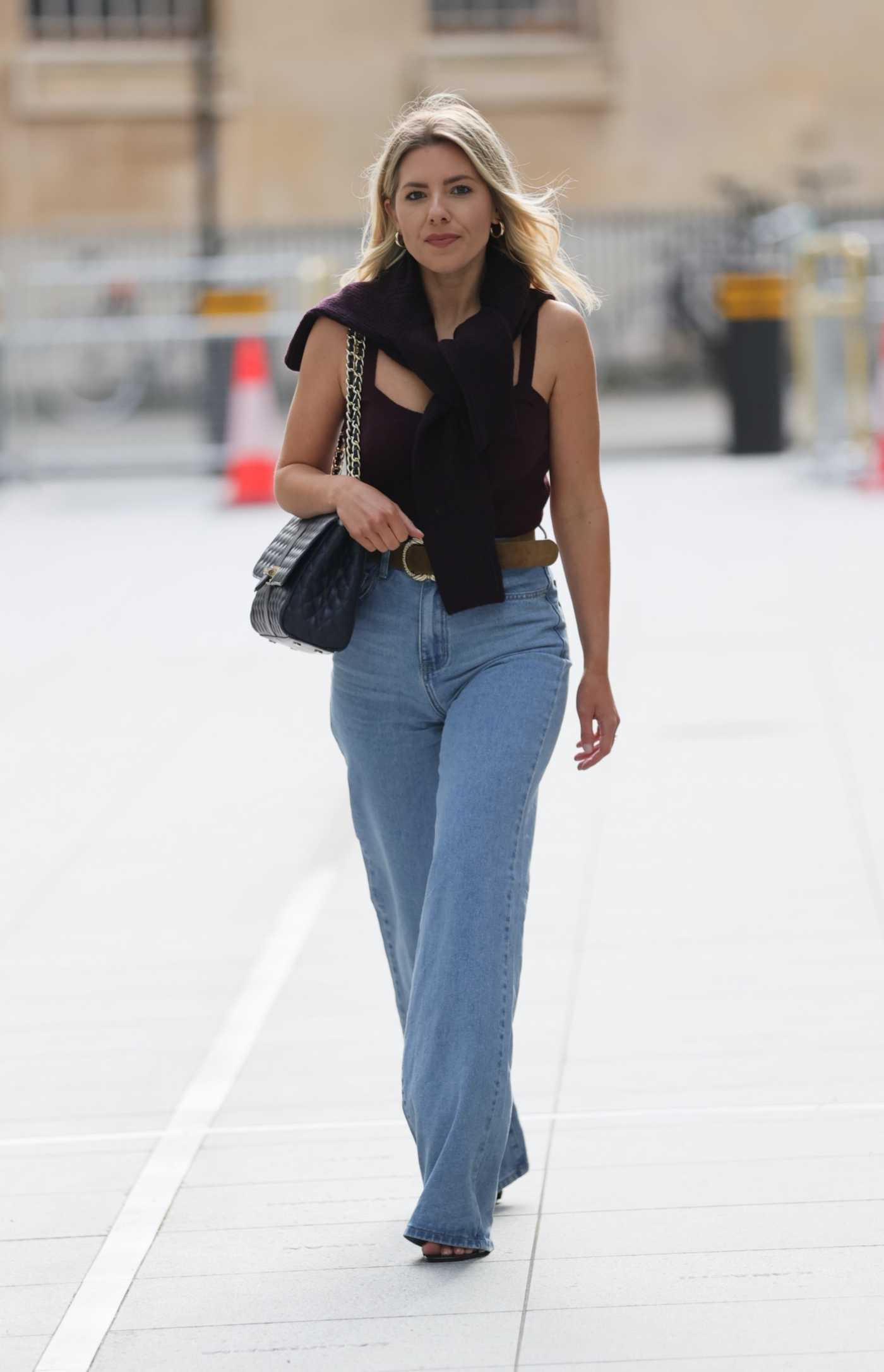 Mollie King in a Light Blue Jeans Arrives at the BBC Studio 1 in London 02/20/2021