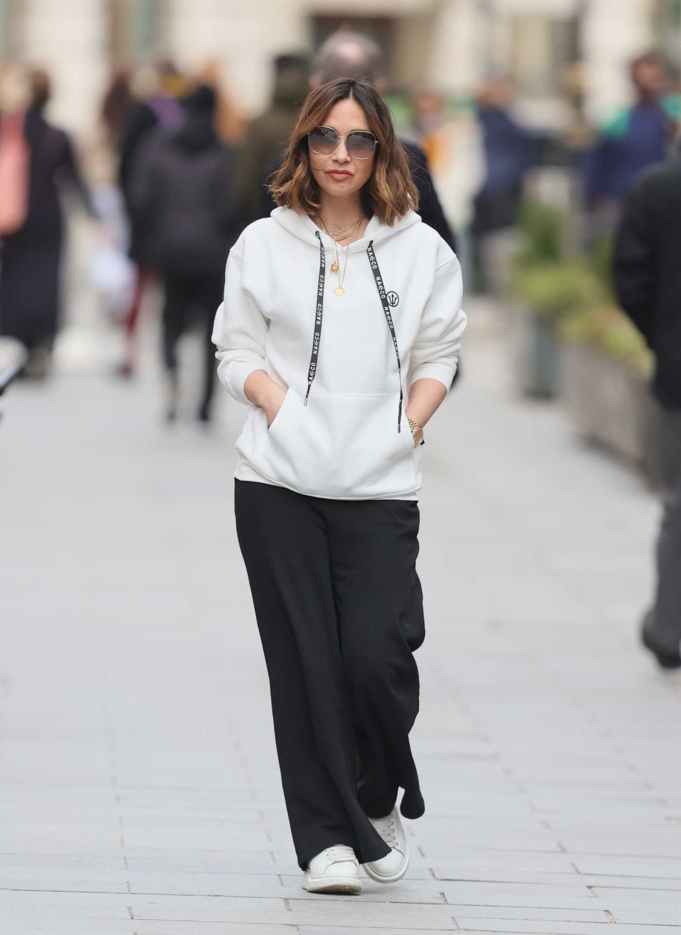 Myleene Klass in a White Hoodie Arrives at the Smooth Radio in London 02/20/2021