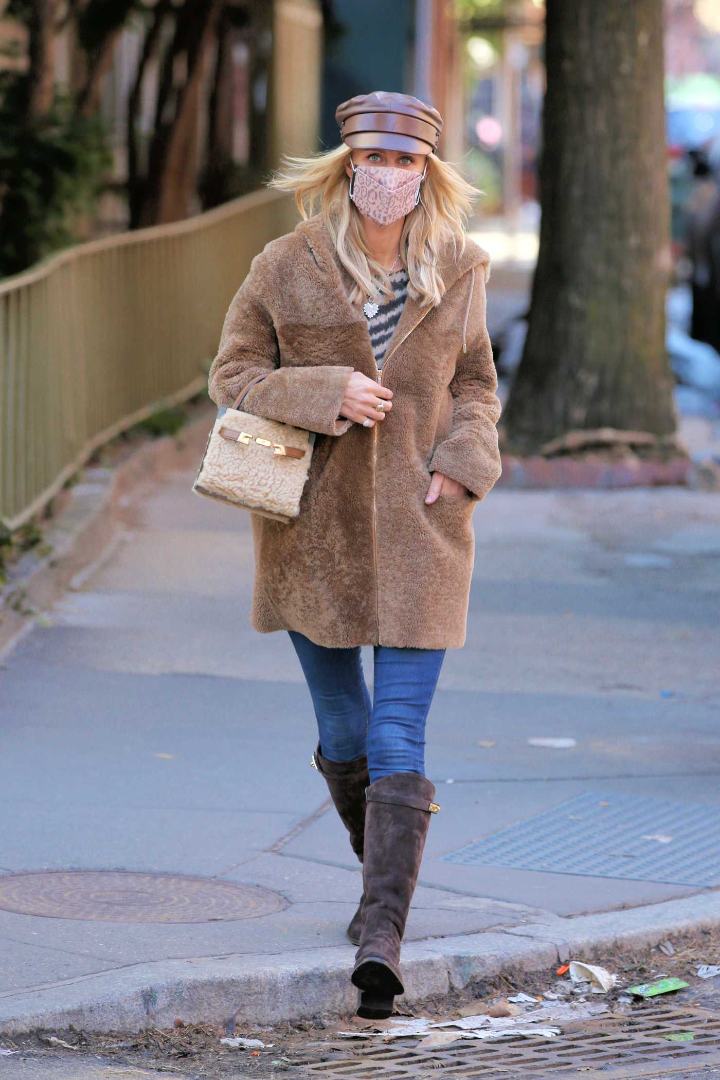 Nicky Hilton in a Beige Fur Coat Walks Home After Lunch at Cafe Cluny in West Village in New York 02/24/2021