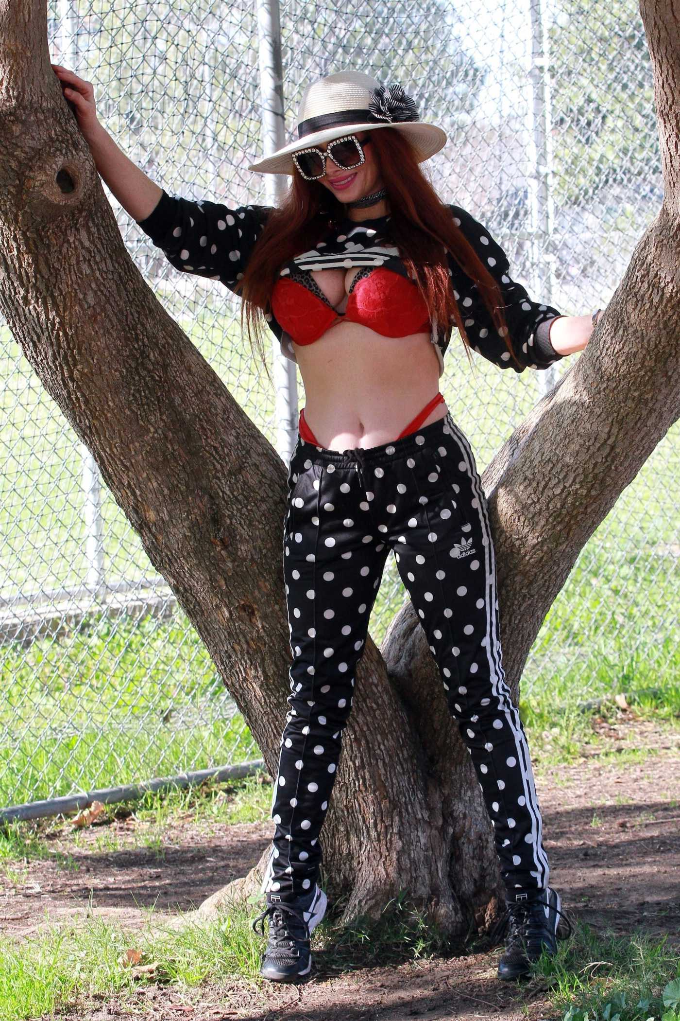 Phoebe Price in a Black Polka Dot Adidas Tracksuit Was Seen Stretching it Out for Tennis in Los Angeles 02/05/2021