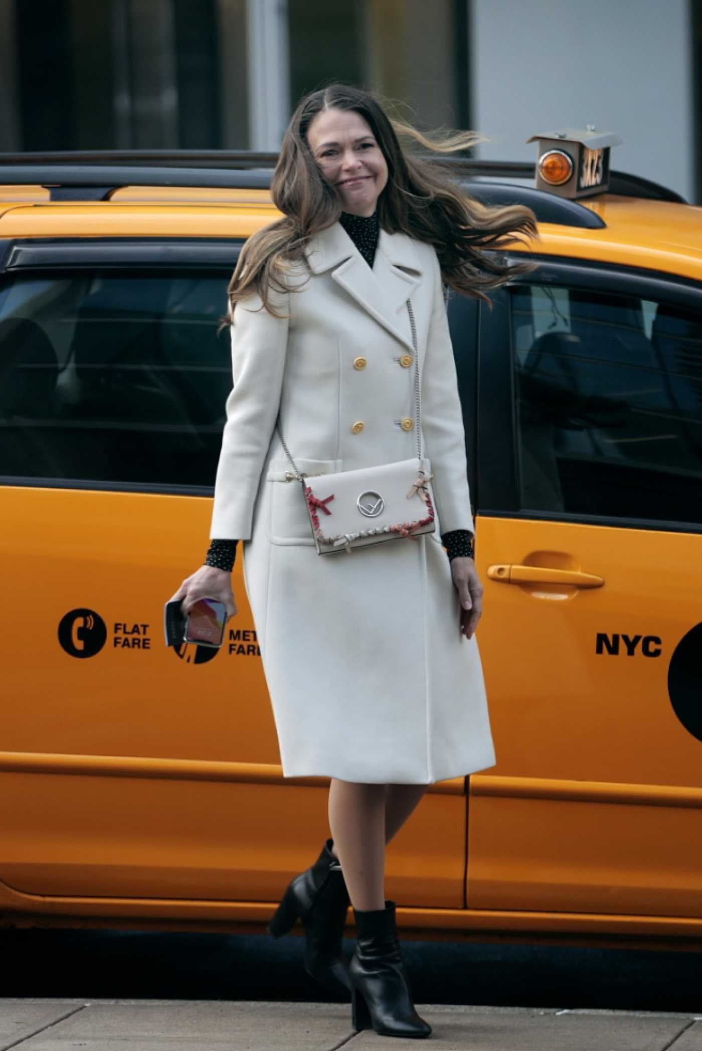 Sutton Foster in a White Coat on the Set of Younger in New York 02/23/2021