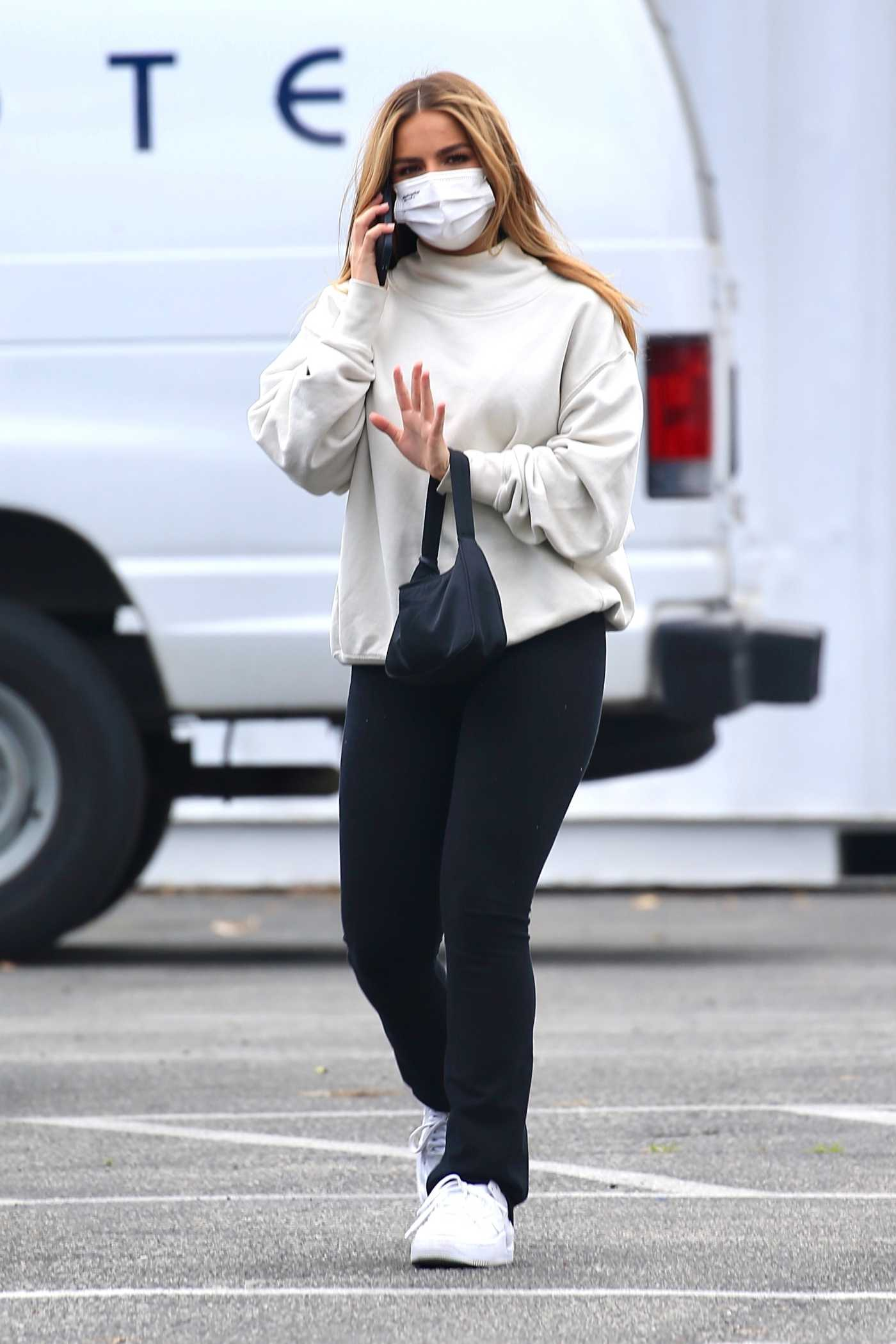 Addison Rae in a White Sneakers Leaves Sunset Towers in West Hollywood 03/25/2021