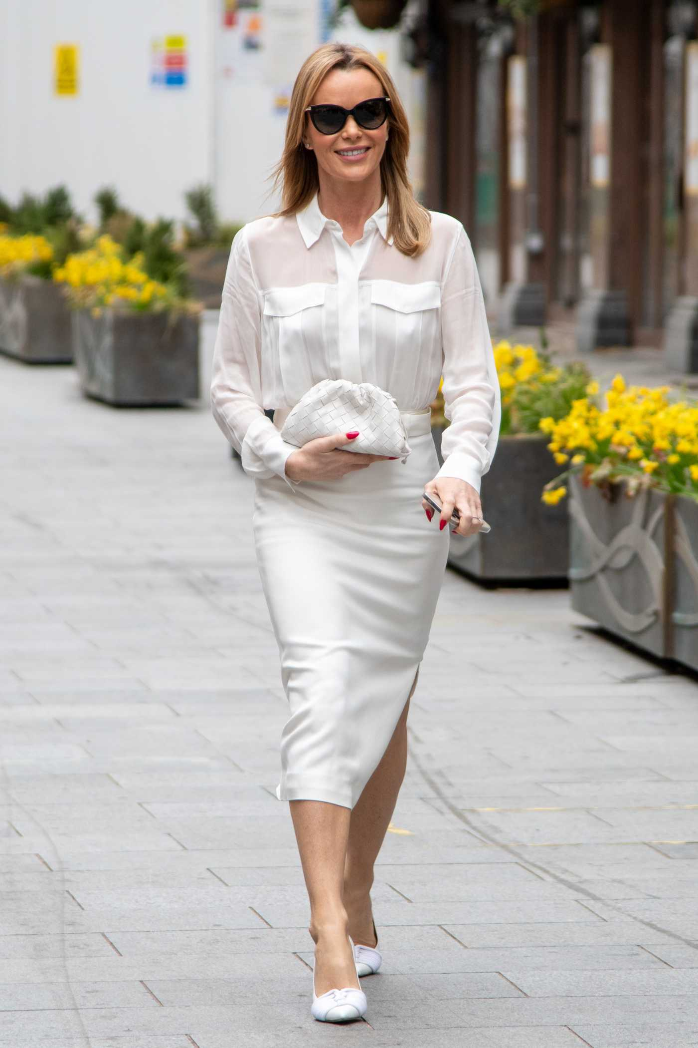 Amanda Holden in a White Ensemble Leaves Her Heart FM Show at the Global Radio Studios in London 03/23/2021