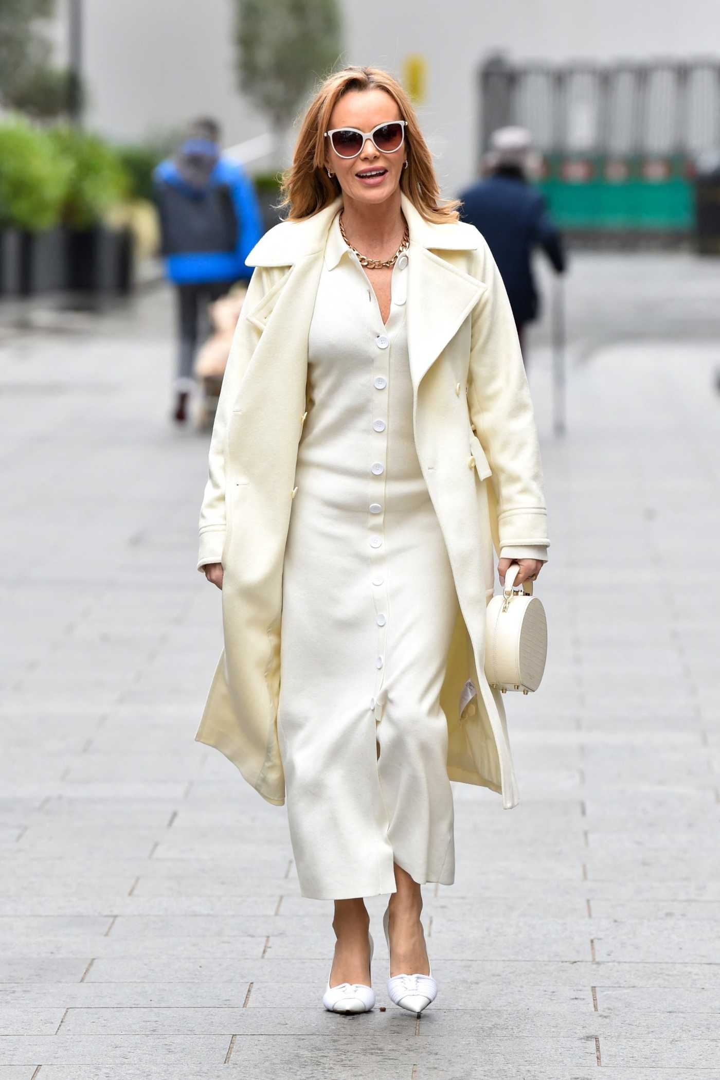 Amanda Holden in a White Outfit Leaves the Global Studios in London 03/18/2021