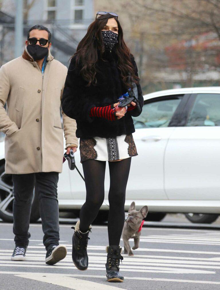 Famke Janssen in a Black Fur Jacket