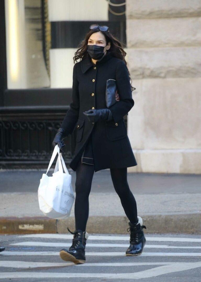 Famke Janssen in a Black Outfit