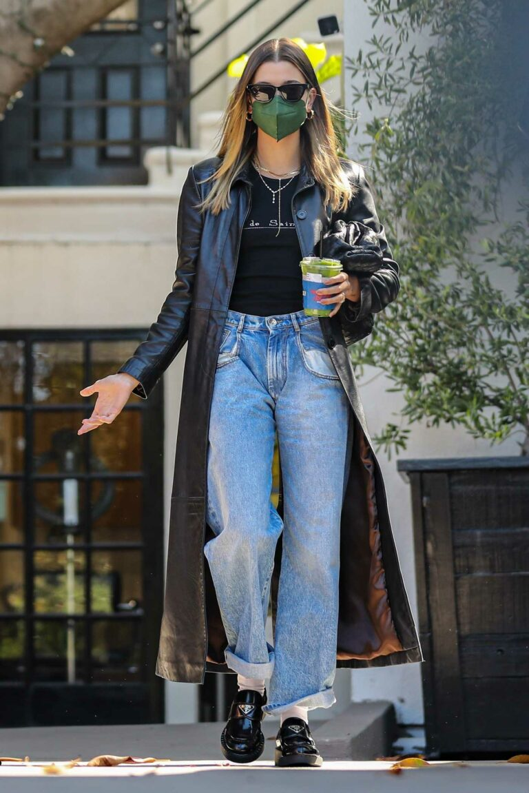 Hailey Baldwin in a Black Leather Trench Coat