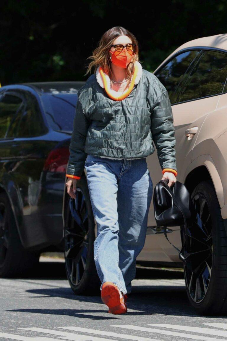 Hailey Baldwin in an Orange Protective Mask