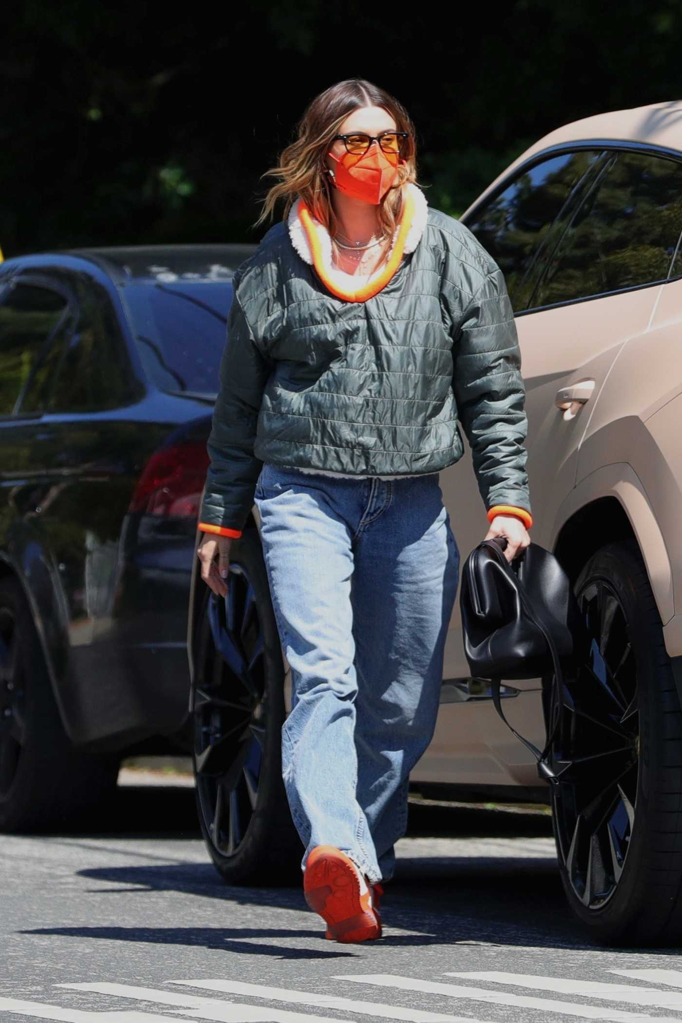 Hailey Baldwin in an Orange Protective Mask Arrives at a Meeting in Beverly Hills 03/13/2021
