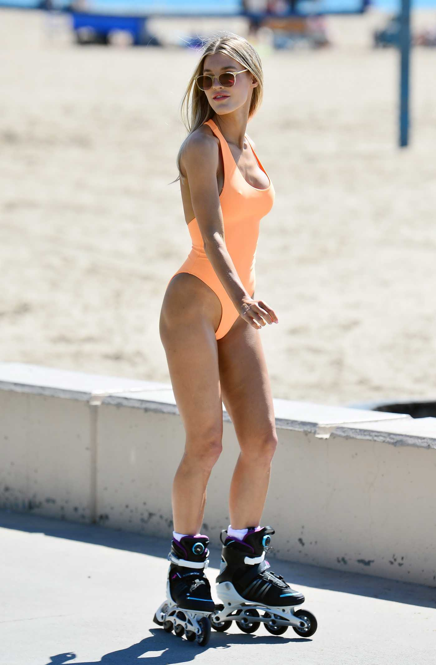 Joy Corrigan in an Orange Swimsuit Shows off Her Rollerblading Skills During a Photoshoot in Los Angeles 03/18/2021