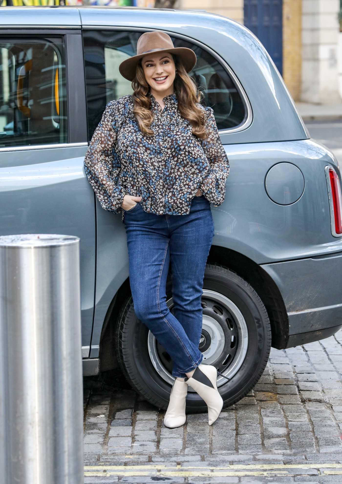 Kelly Brook in a Floral Blouse Arrives at the Global Radio Studios in London 03/15/2021