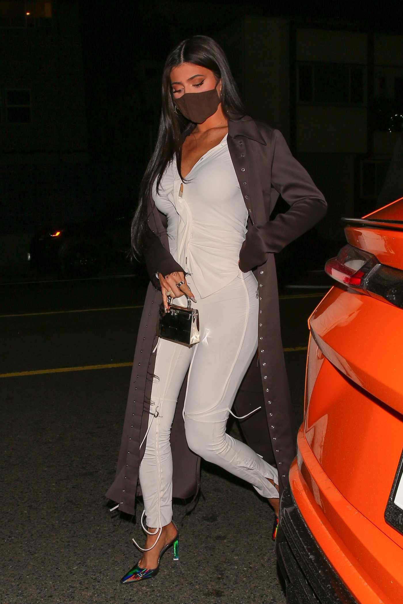 Kylie Jenner in a Brown Trench Coat Leaves Dinner with Friends at Giorgio Baldi in Santa Monica 03/03/2021
