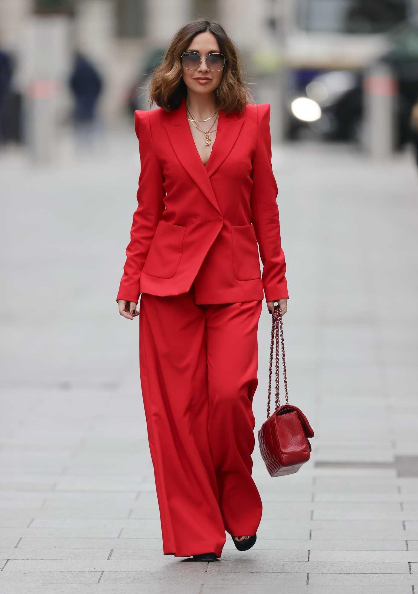 Myleene Klass in a Red Pantsuit Arrives  at the Smooth Radio in London 03/20/2021