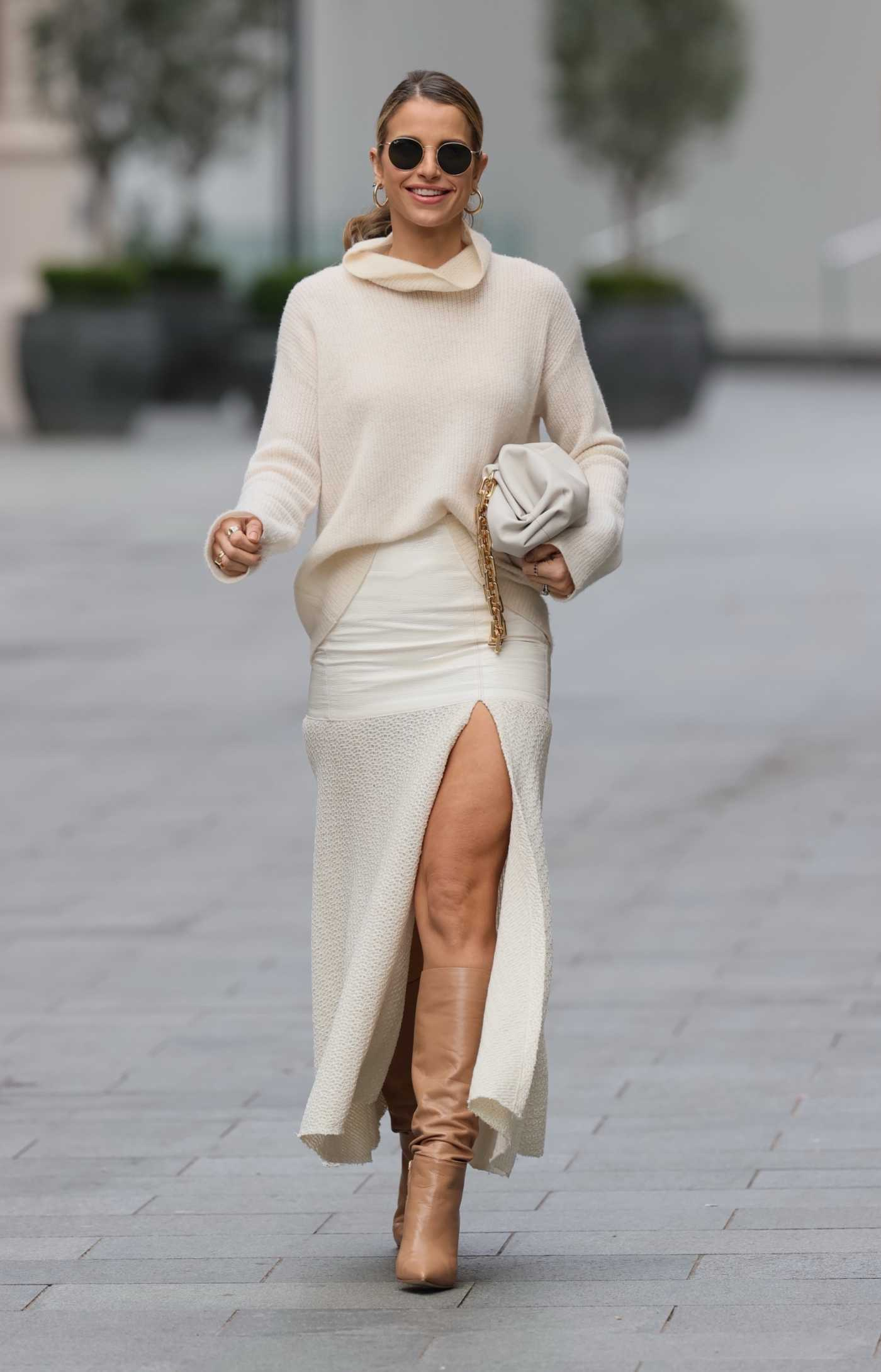 Vogue Williams in a Beige Roll Neck Knitted Jumper Was Seen Out in London 03/21/2021