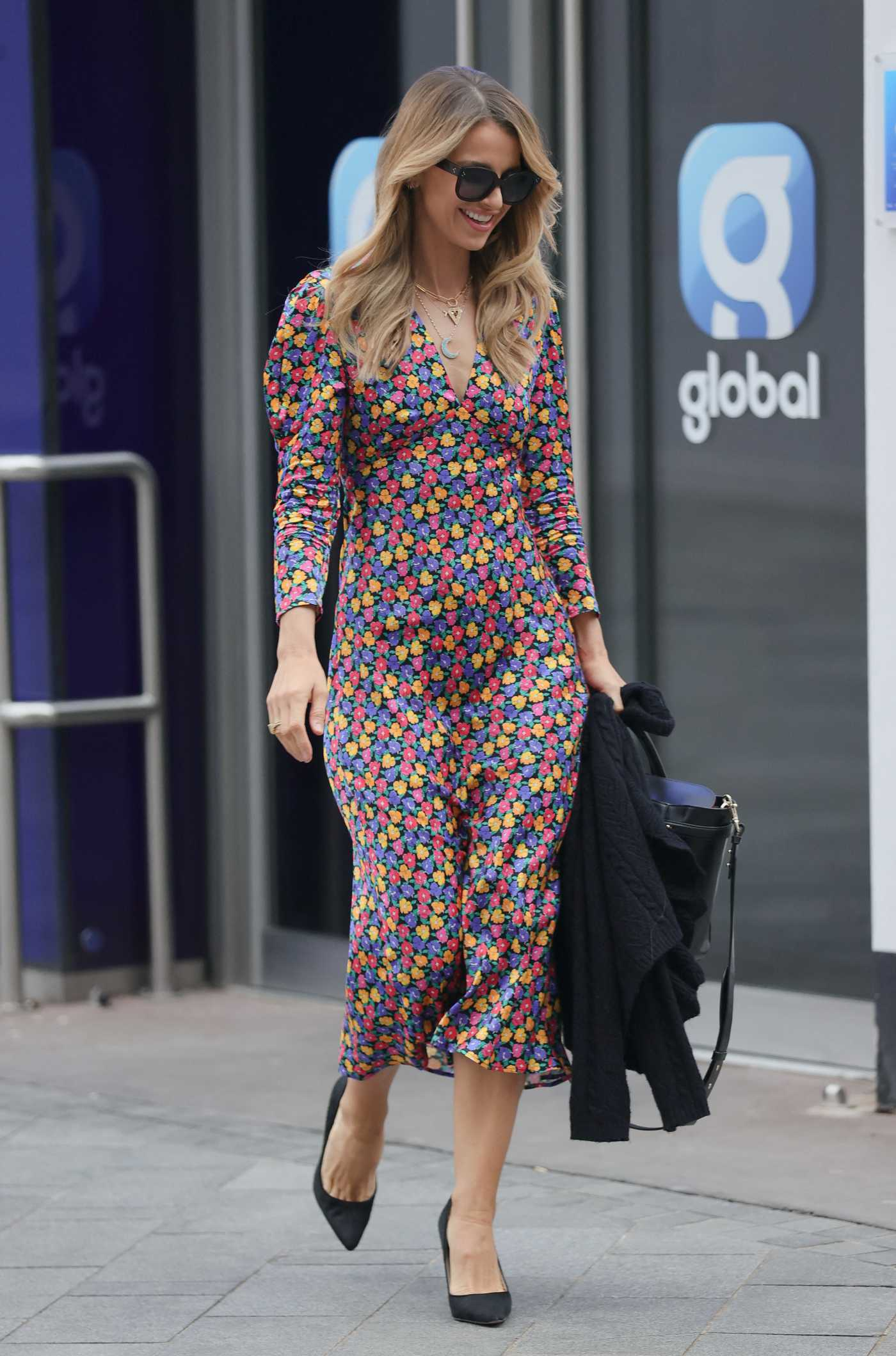 Vogue Williams in a Floral Dress Leaves the Global Radio in London 03/28/2021