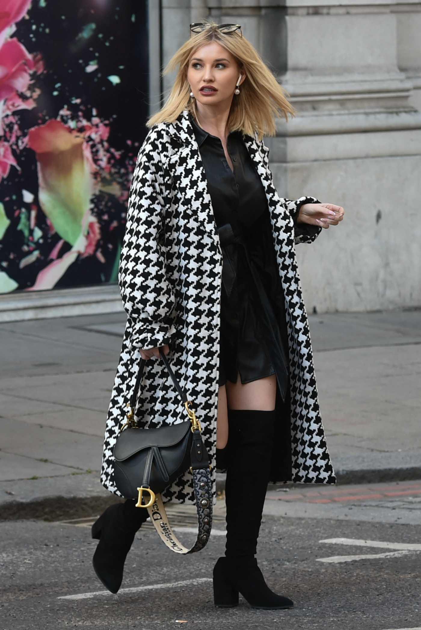 Amy Hart in a Black Mini Dress Was Seen Out in London 04/25/2021