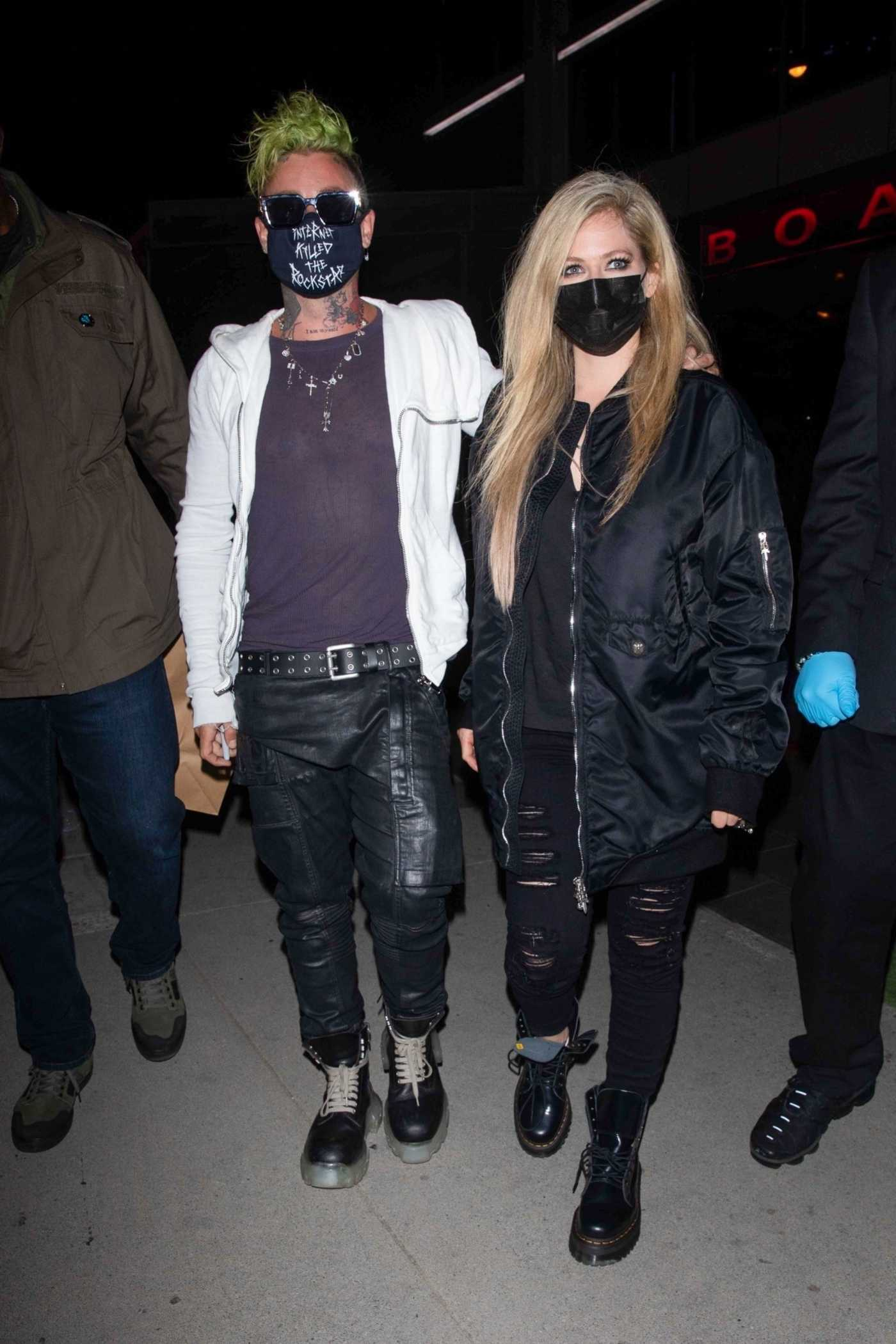 Avril Lavigne in a Black Bomber Jacket Enjoys a Date Night with Mod Sun at the BOA Steakhouse in Los Angeles 04/22/2021