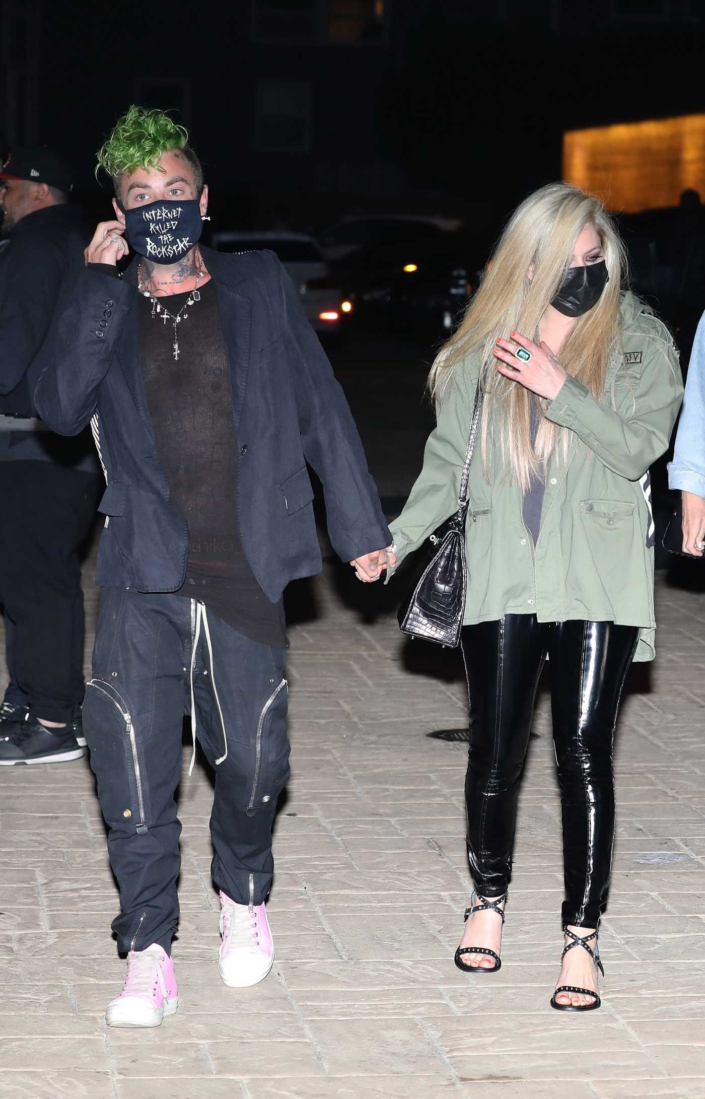 Avril Lavigne in an Olive Jacket Walks to Soho House with Mod Sun in Malibu 04/09/2021