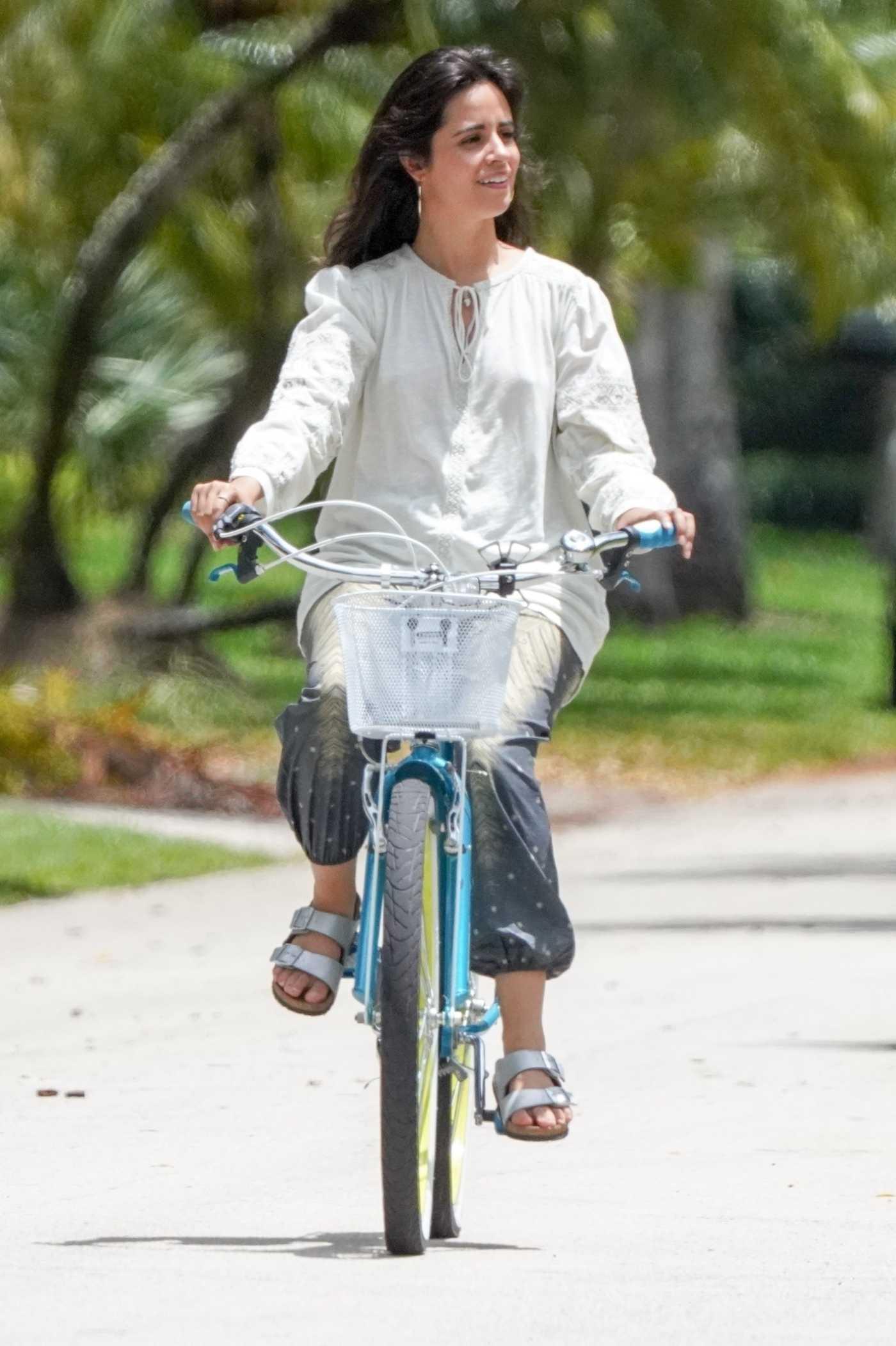 Camila Cabello in a White Blouse Does a Bike Ride in Miami 04/28/2021