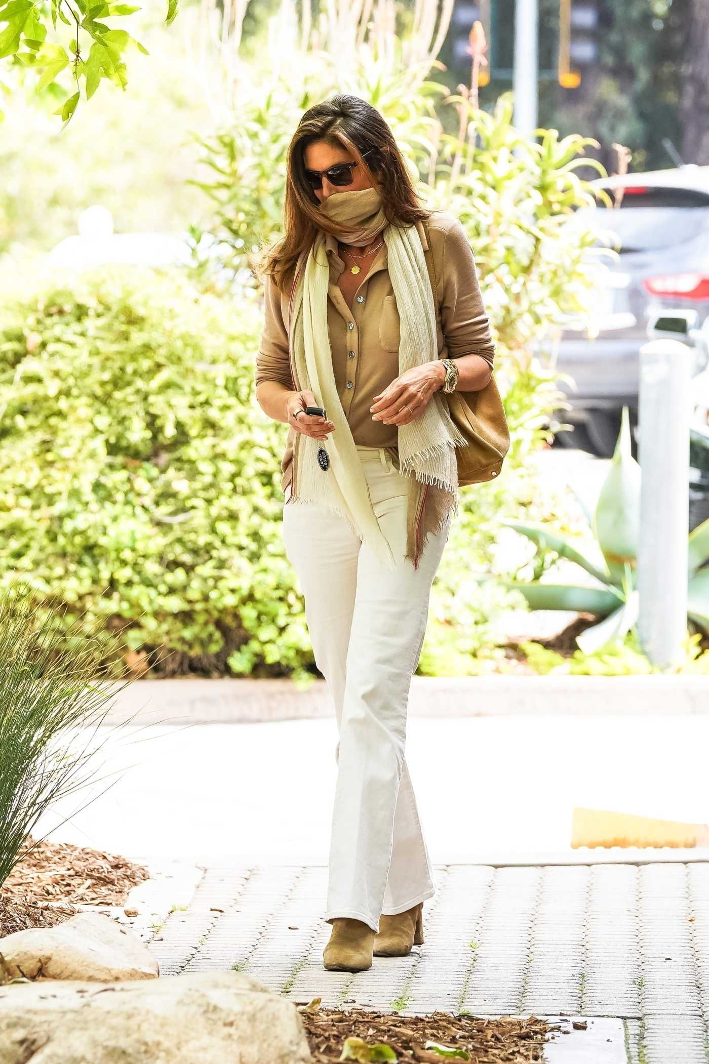 Cindy Crawford in a White Jeans Makes a Quick Visit to Cafe Habana in Malibu 04/13/2021