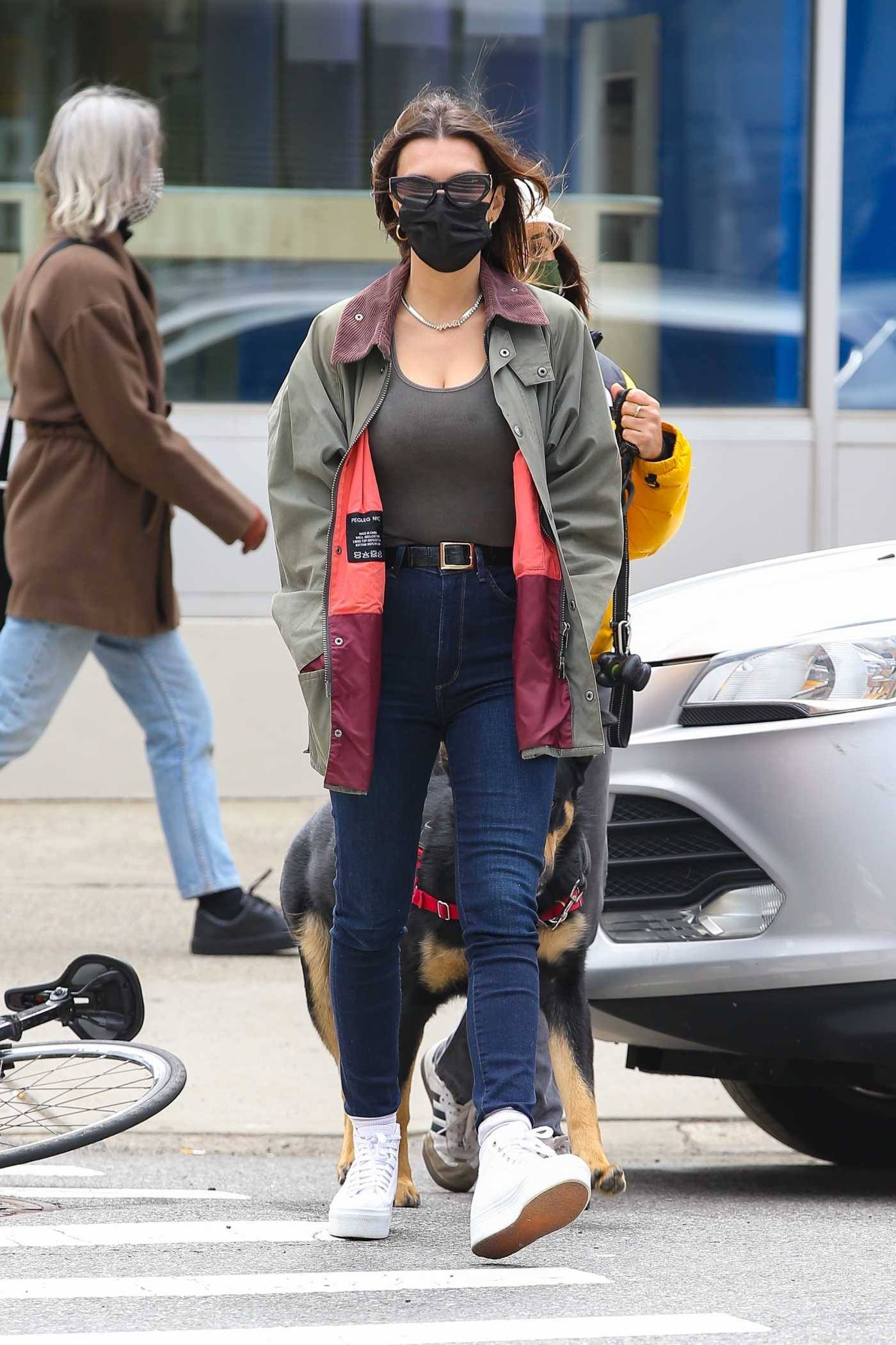 Emily Ratajkowski in an Olive Jacket Enjoys a Stroll with Friends and Her Dog in New York 04/22/2021