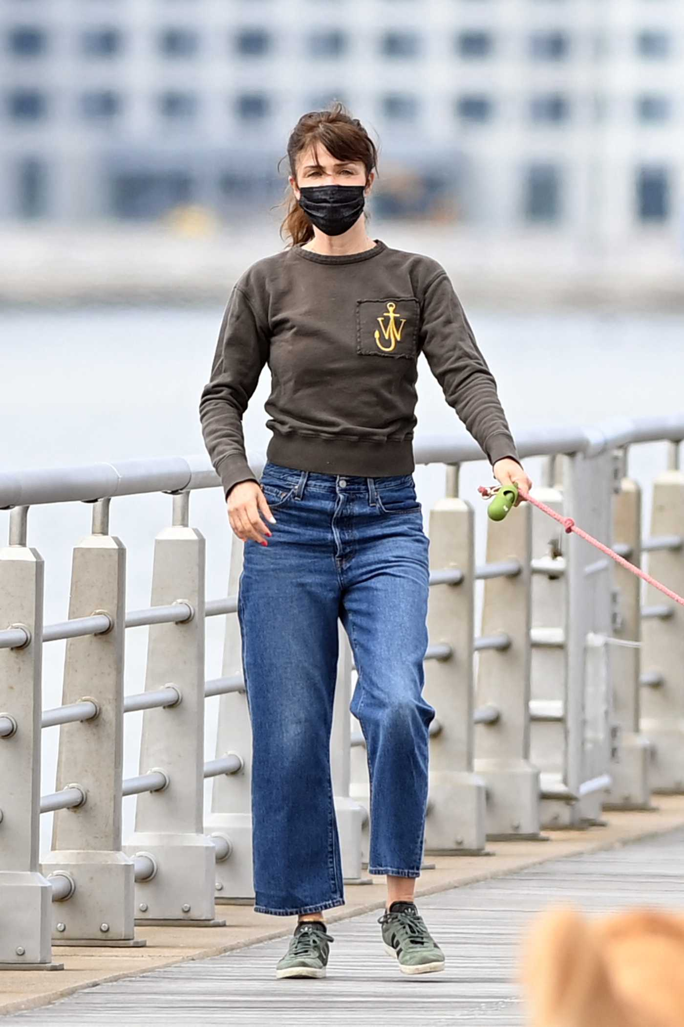 Helena Christensen in a Black Protective Mask Walks Her Dog in New York 04/18/2021