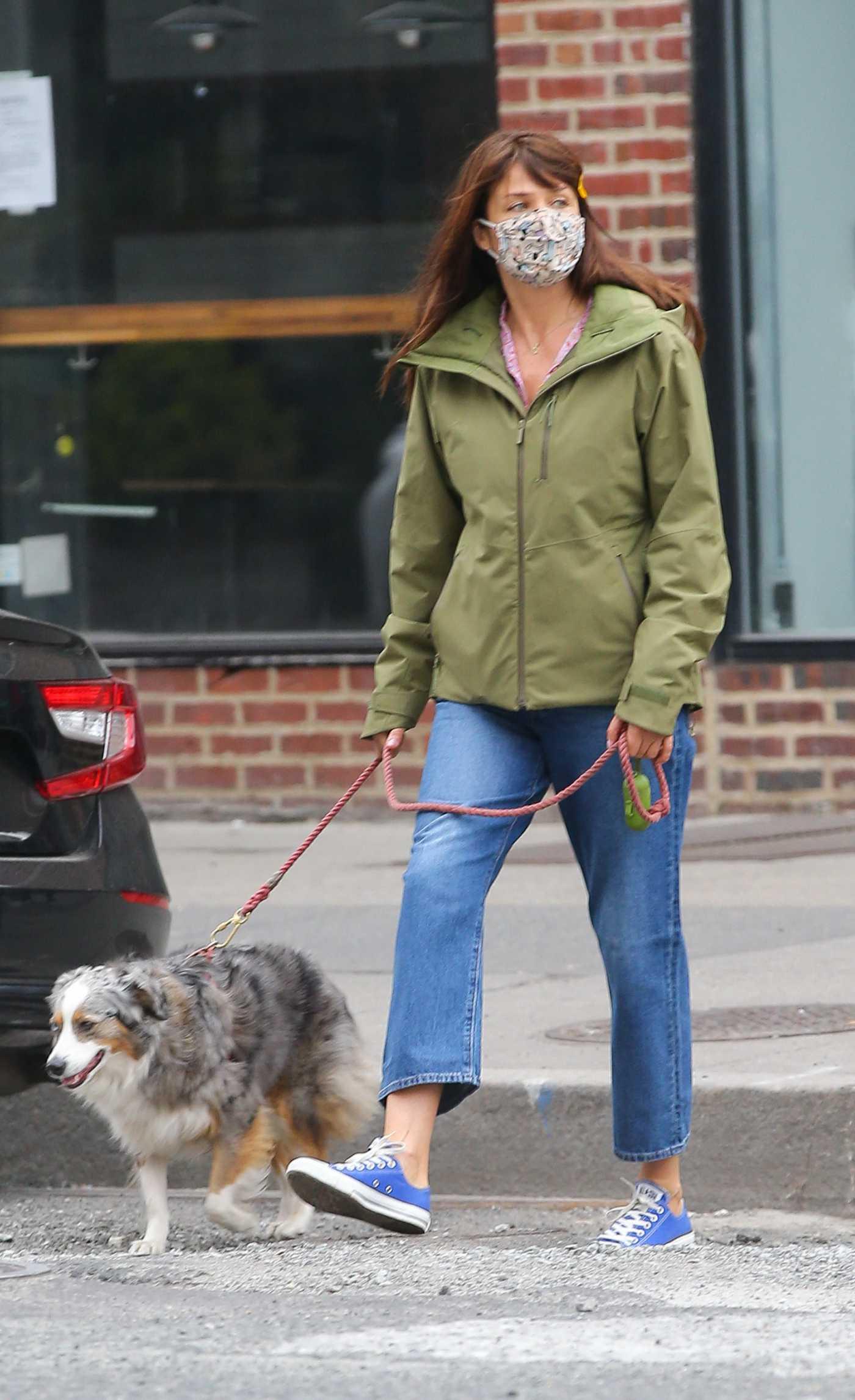 Helena Christensen in an Olive Jacket Walks Her Dog in the West Village 04/09/2021