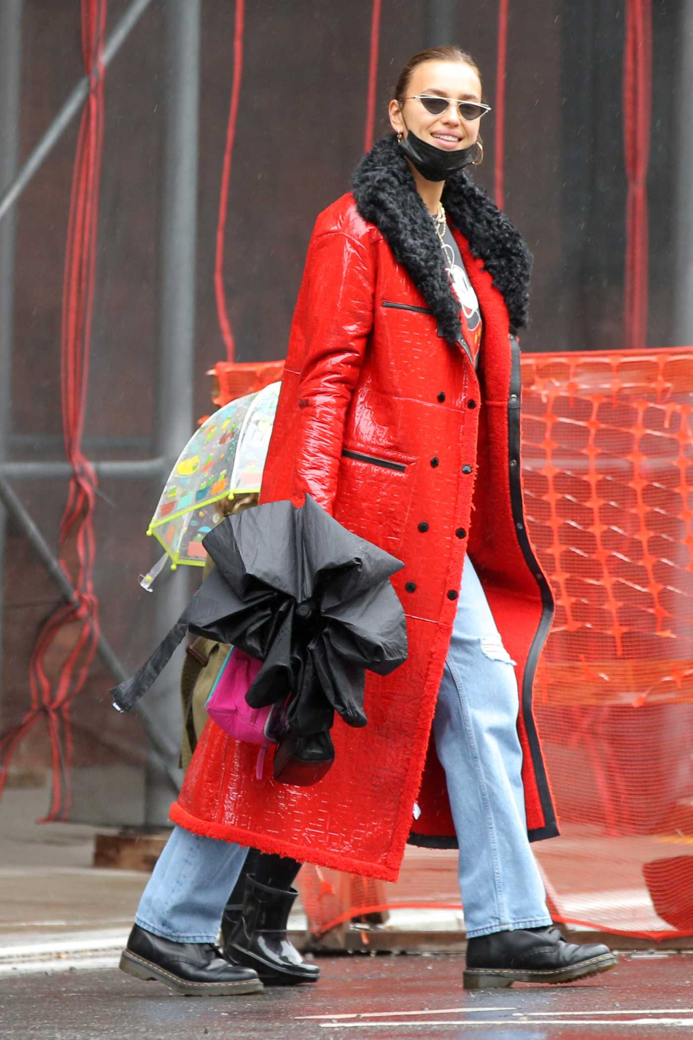 Irina Shayk in a Red Coat Walks to Lunch on Rainy Day in West Village in New York 04/11/2021