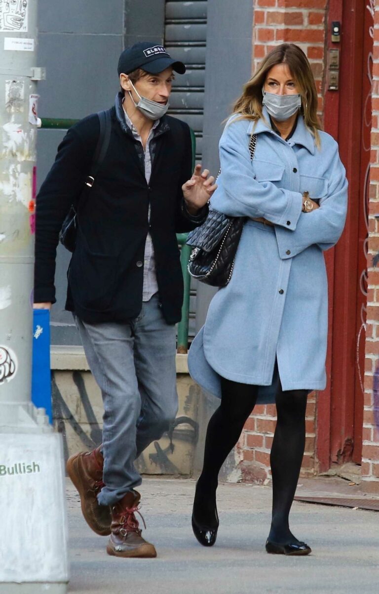 Kelly Bensimon in a Blue Cardigan
