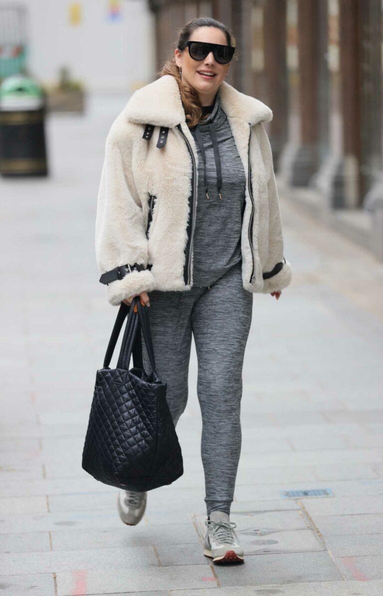 Kelly Brook in a Beige Fur Jacket