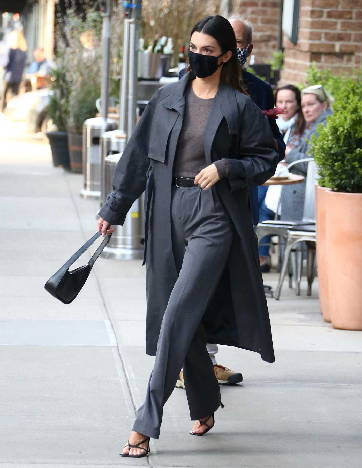 Kendall Jenner in a Black Trench Coat Leaves Her Hotel in Tribeca, New York 04/27/2021