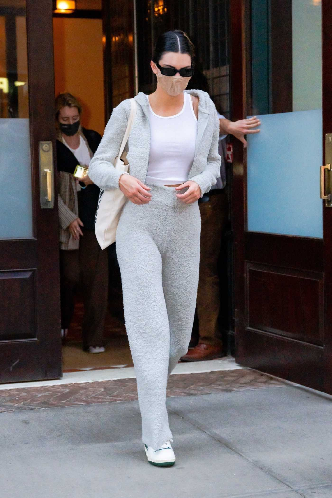 Kendall Jenner in a Grey Sweatsuit Leaves the Greenwich Hotel in New York 04/28/2021
