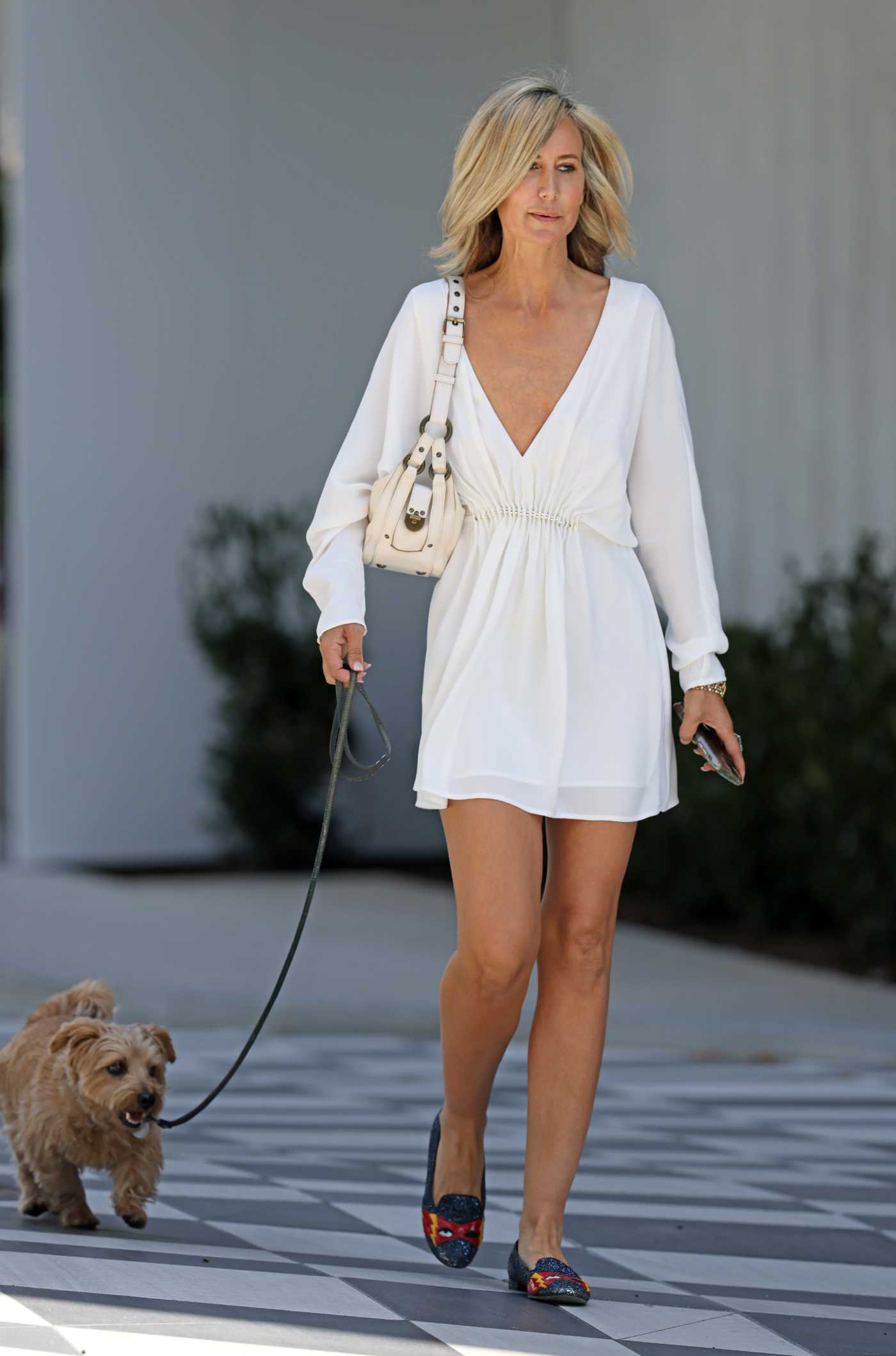 Lady Victoria Hervey in a White Mini Dress Was Seen Out with Sean Borg Outside of the Pendry Hotel in West Hollywood 04/16/2021