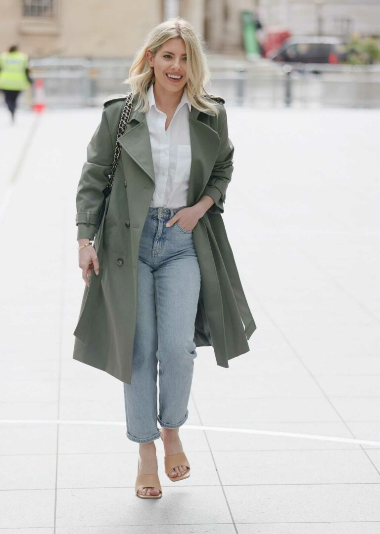 Mollie King in an Olive Trench Coat