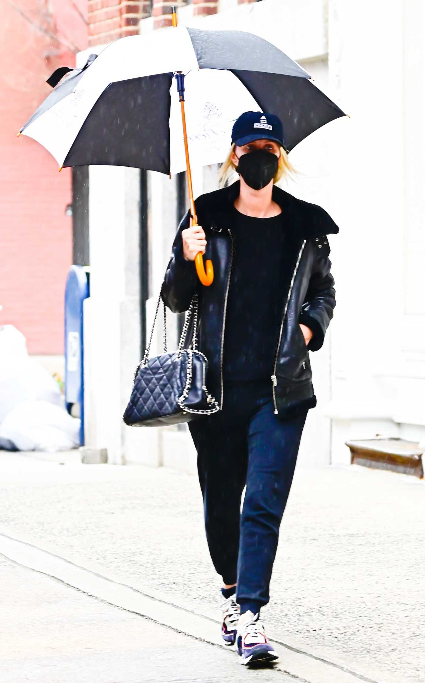 Nicky Hilton in a Black Protective Mask Goes on a Stroll Under the Rain in New York 04/01/2021