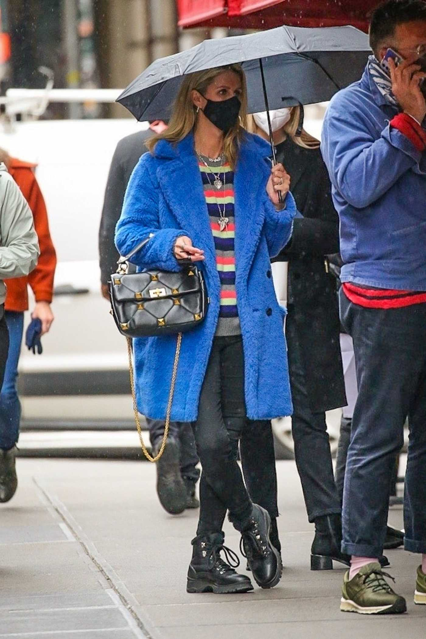 Nicky Hilton in a Blue Faux Fur Coat Was Spotted Under the Rain in New York 04/12/2021