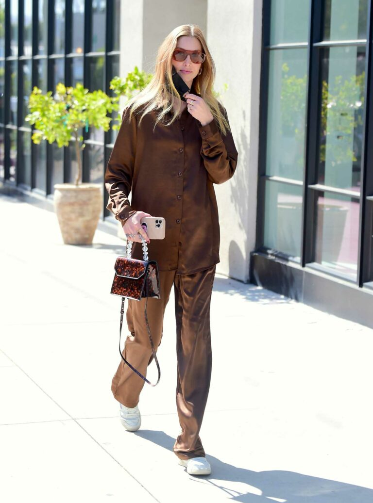 Whitney Port in a Brown Satin Ensemble
