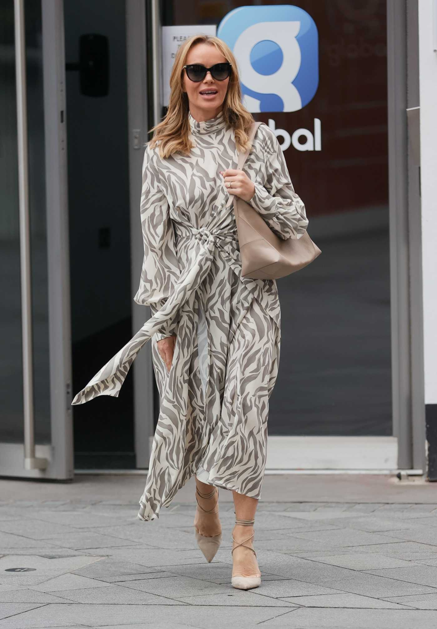 Amanda Holden in a Flowing Monochrome Dress Leaves the Heart Radio in London 05/20/2021