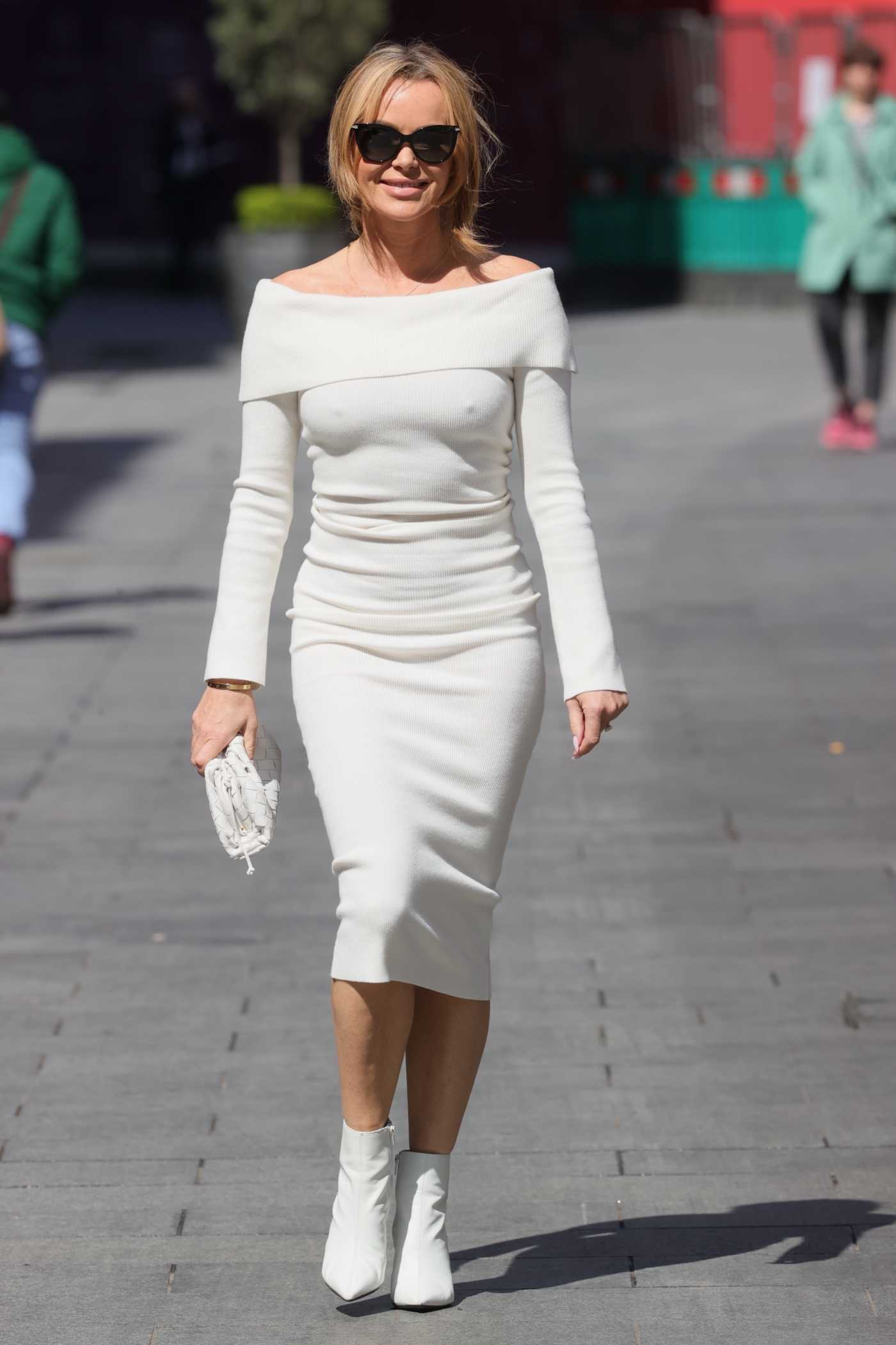 Amanda Holden in a White Tight Dress Arrives at the Heart Radio in London 05/19/2021
