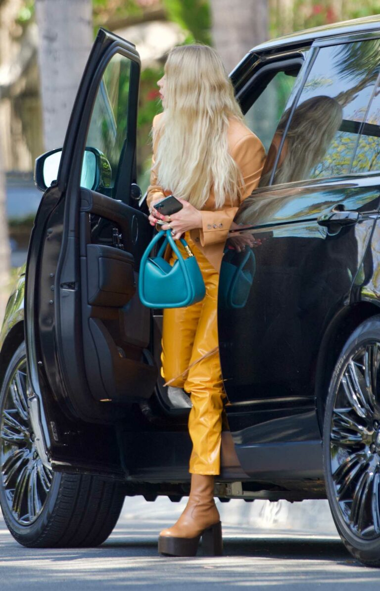 Ashley Benson in a Yellow Pants