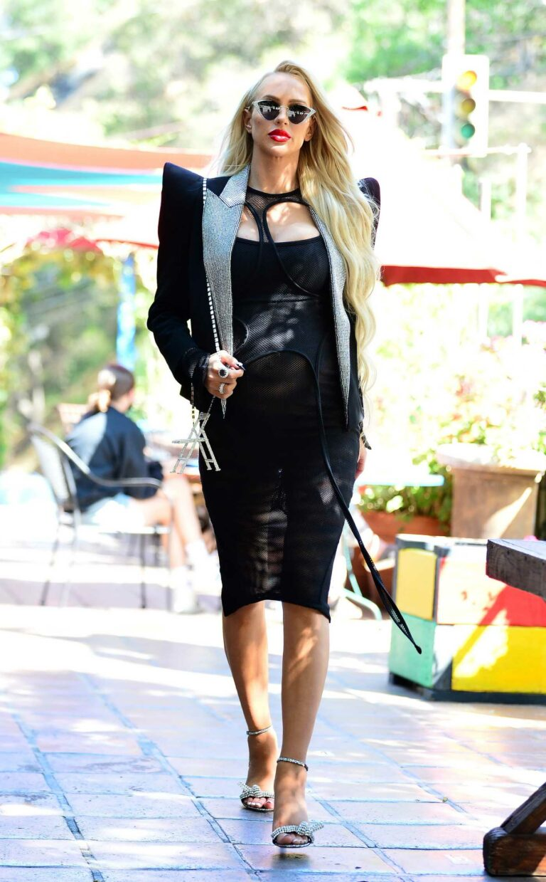 Christine Quinn in a Black Dress