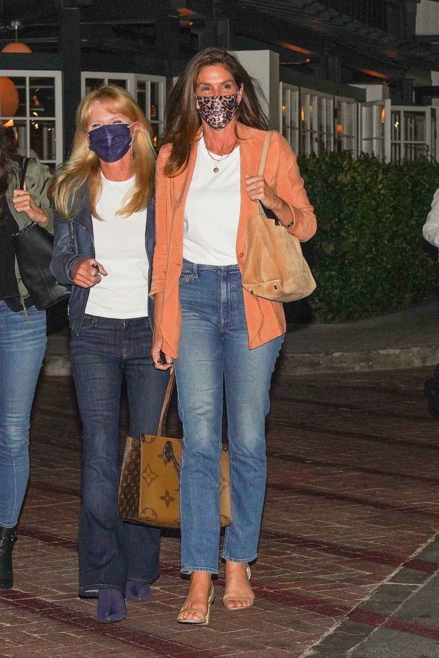 Cindy Crawford in an Orange Blazer Leaves the Lucky Restaurant in Malibu 04/29/2021