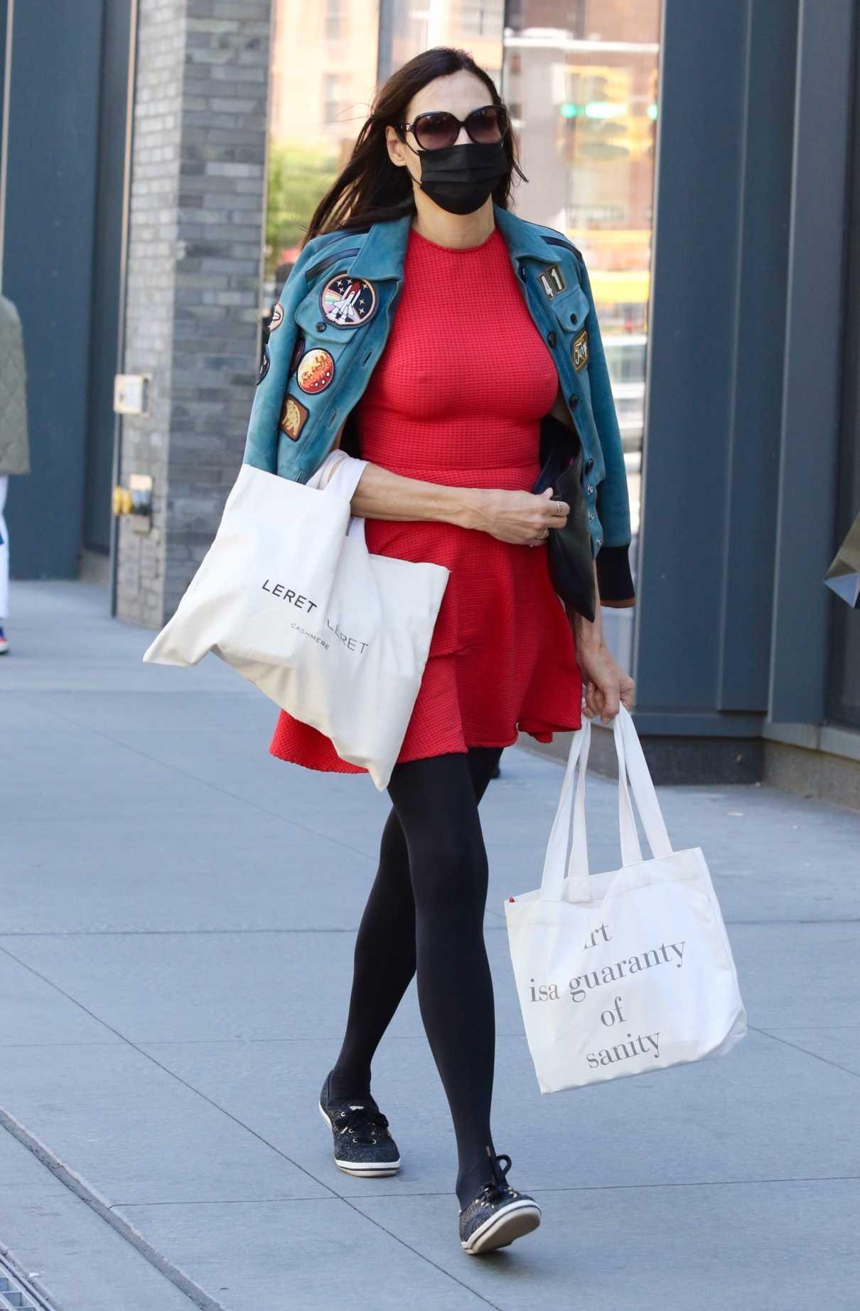 Famke Janssen in a Red Mini Dress Goes Grocery Shopping in New York City 05/06/2021