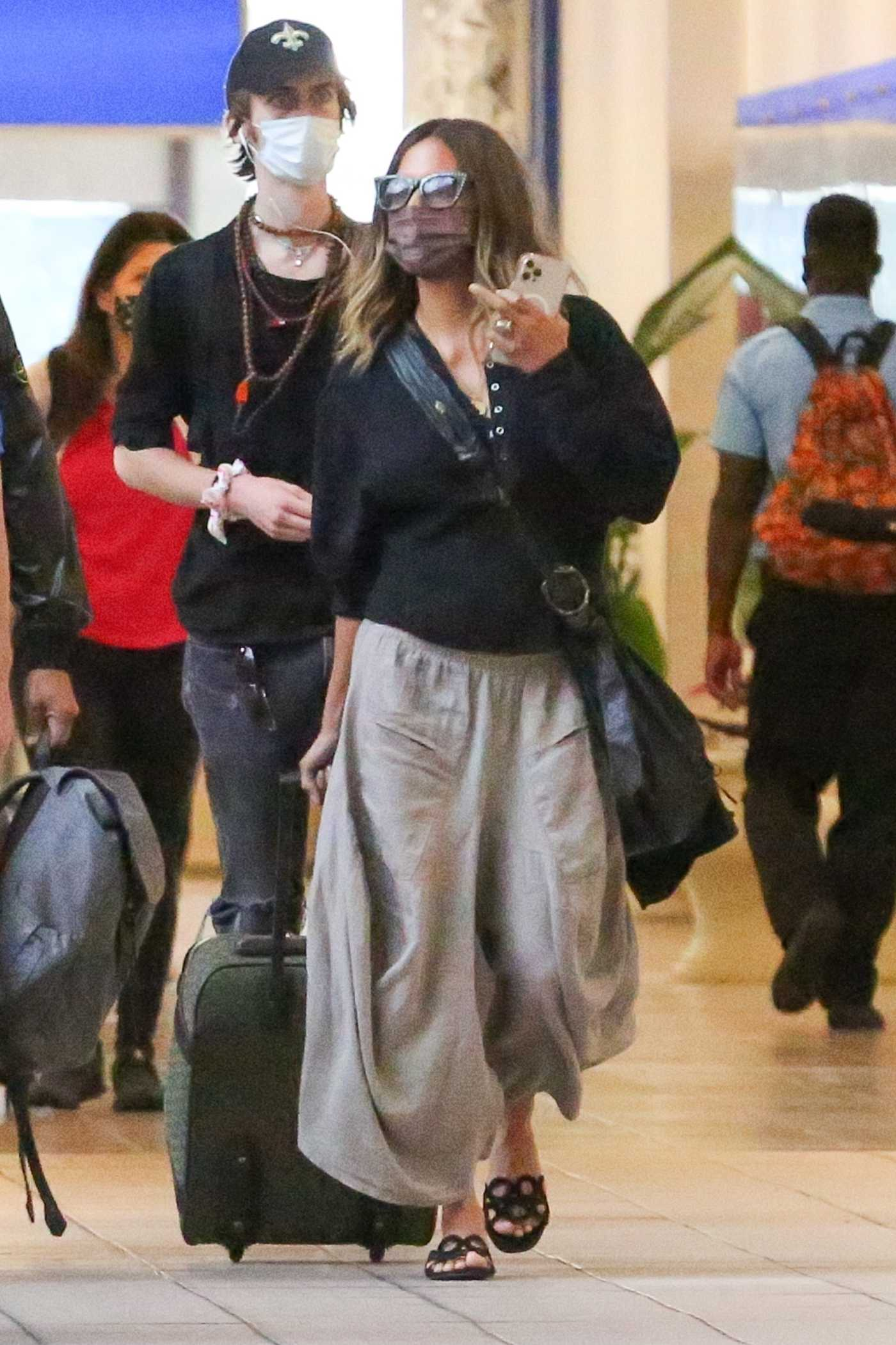 Halle Berry in a Black Blouse Arrives at Orlando International Airport in Orlando 05/05/2021
