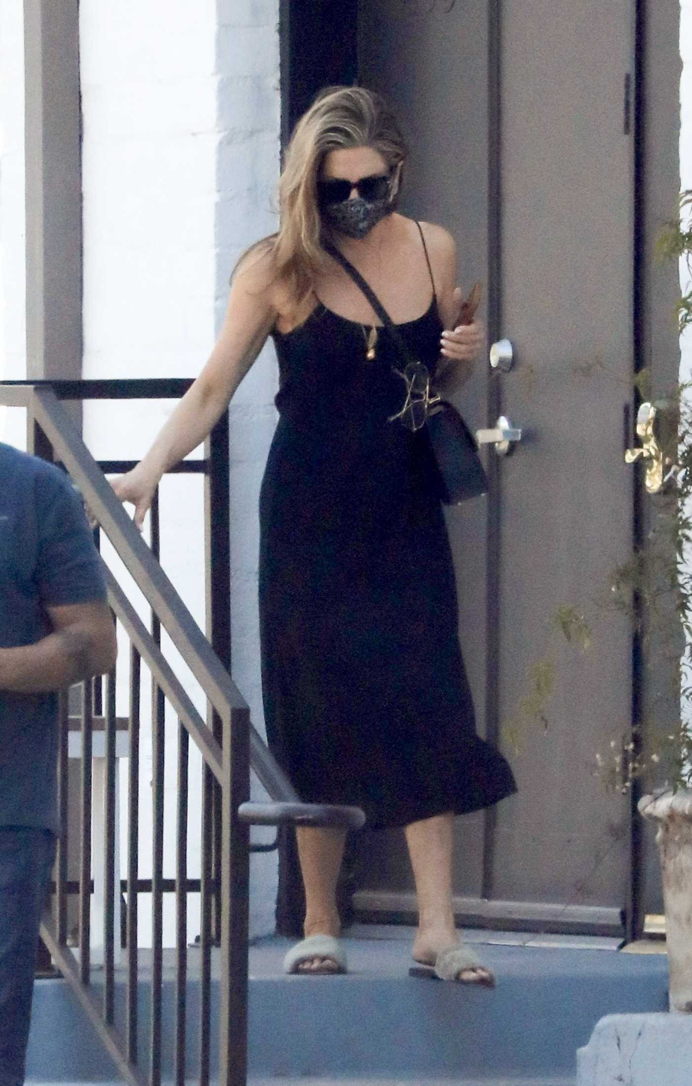 Jennifer Aniston in a Black Dress Leaves a Hair Salon in Beverly Hills 05/23/2021