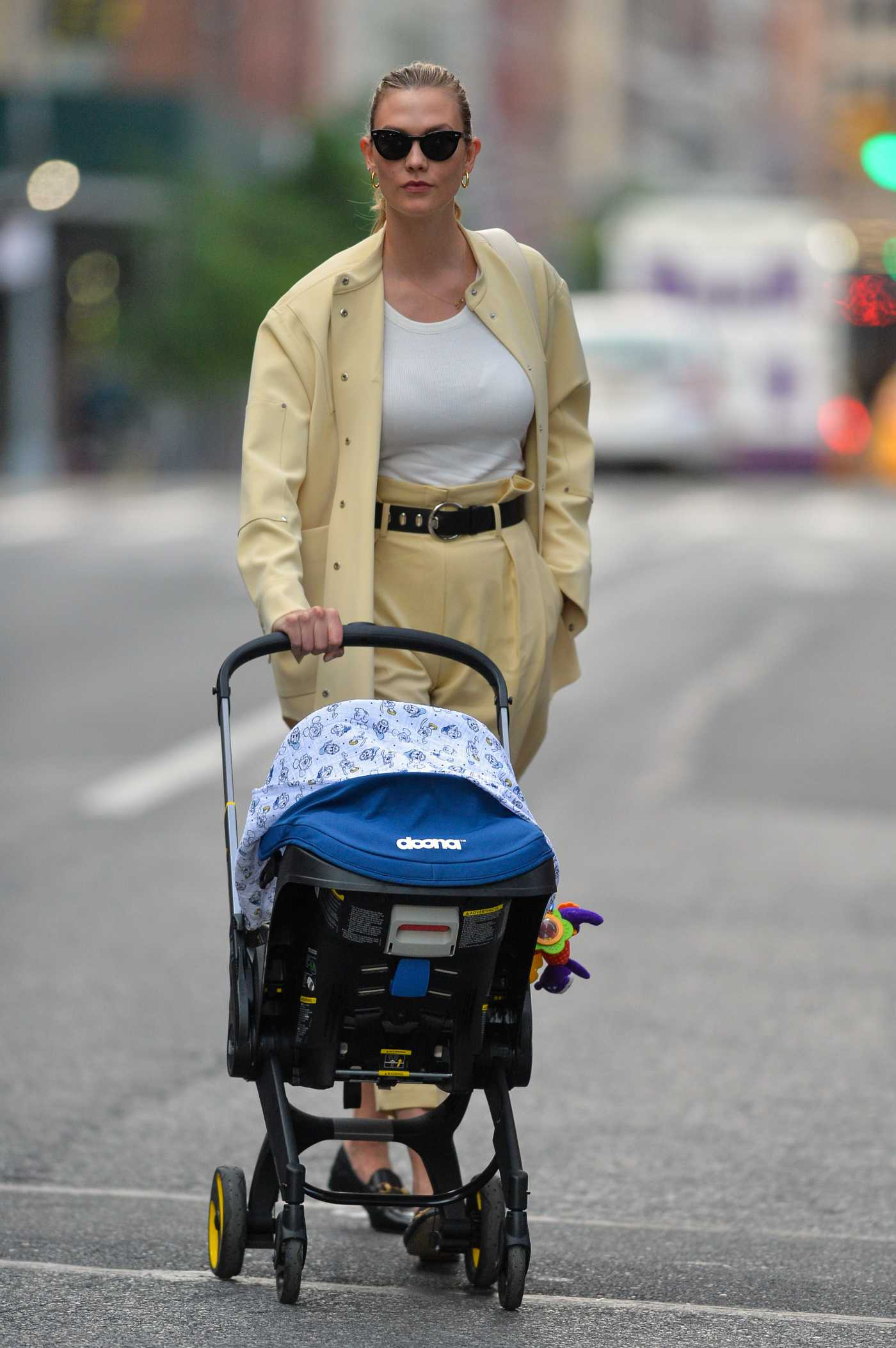 Karlie Kloss in a Yellow Suit Steps Out Pushing a Pram in New York 05/23/2021