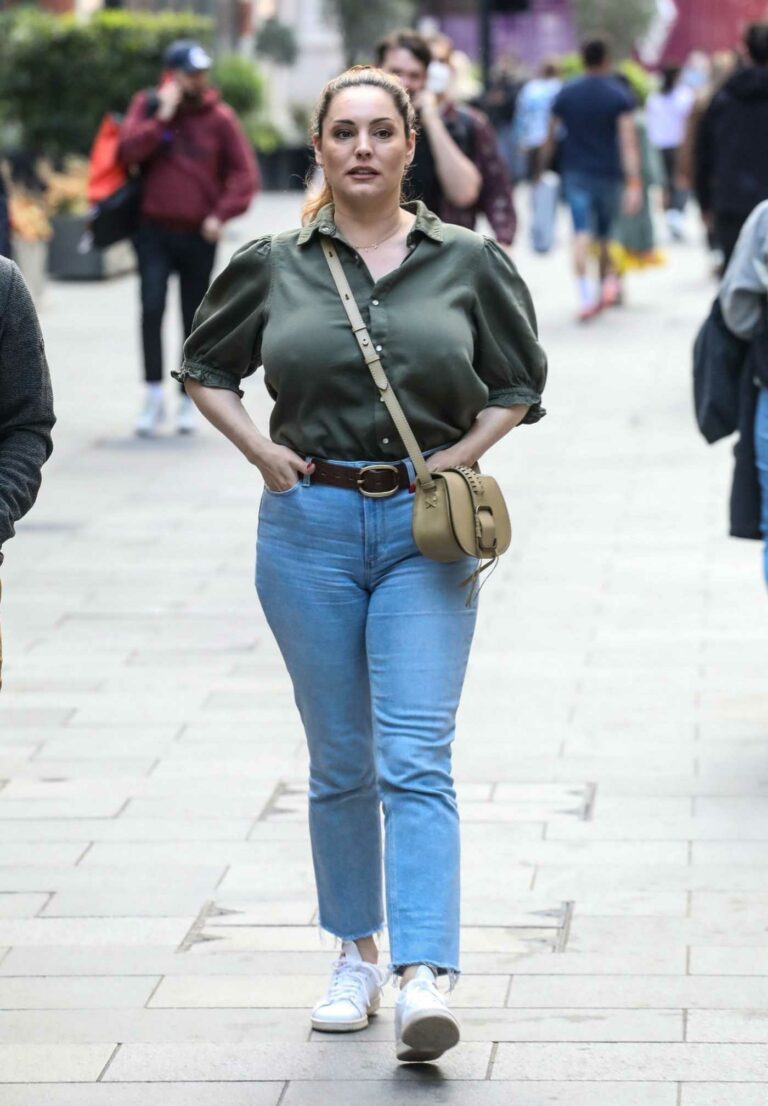 Kelly Brook in an Olive Blouse