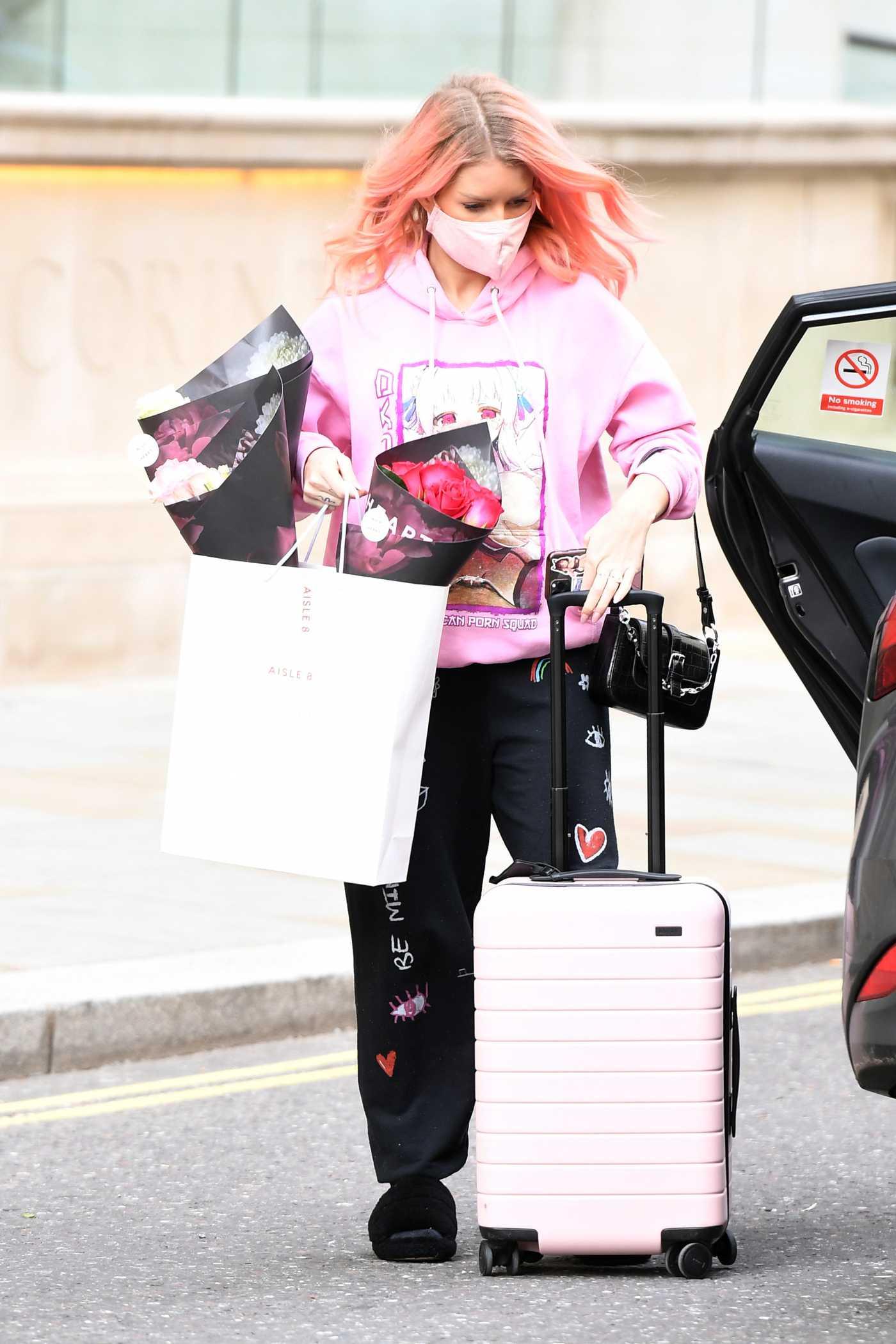 Lottie Moss in a Pink Hoodie Leaves the Corinthia Hotel in London 05/25/2021