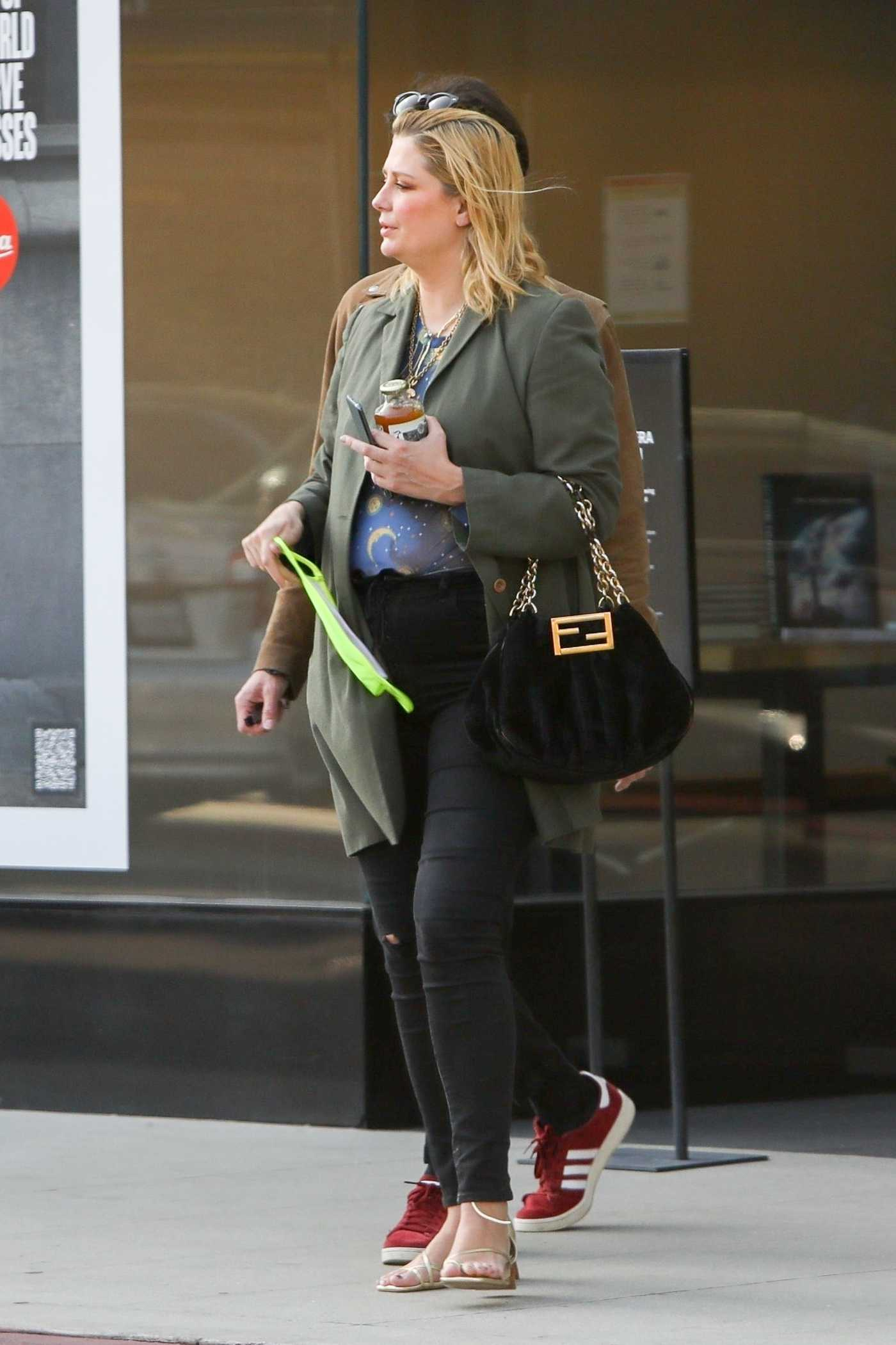 Mischa Barton in an Olive Jacket Goes Shopping with Her Boyfriend Gian Marco Flamini at Leica Camera Store in Los Angeles 05/07/2021